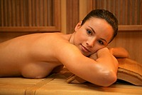 Naked woman in sauna