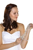 beauty bride in white dress and bride´s jewels