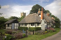 Thatched Cottages and Church of Welford on - Avon Warwickshire