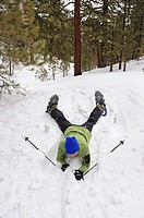 Woman fall down with snowshoes, Mt Pinos, California, USA