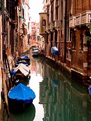 Canal with boats. Venice, Italy.