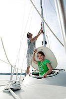 young girl and father on sailing ship