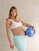 Pregnant woman holding ball