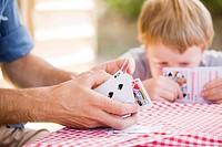 Father and son playing card game