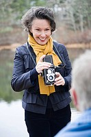 Mature woman using camera