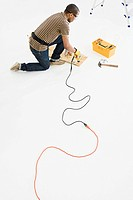 Man using power drill (thumbnail)