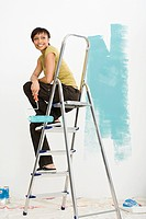 Woman on stepladder