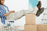 Man with feet up on boxes