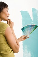 Woman choosing paint color