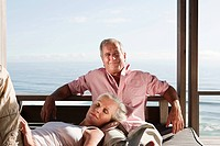 Couple relaxing at beach house