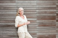 Mature woman by wooden wall