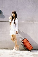 Girl Standing with Luggage