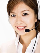 Businesswoman wearing a hands_free headset