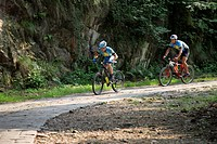 Male cyclists riding on the mountain