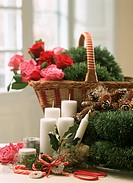 Bunch of flowers in wicker basket with candles