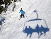 Skier and shadow of chairlift at Romme Alpin Ski area in the province of Dalarna, Borlange, Sweden