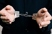 Businessman in Handcuffs Close Up