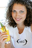Woman drinking a glass of fruit juice