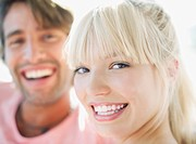 Close up of man and woman smiling