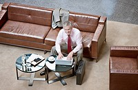 Businessman using laptop in lobby
