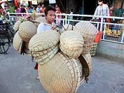 Myanmar, Burma, Yangon, Rangoon, basket vendor, street scene