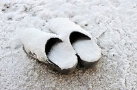 A pair of clogs covered with snow