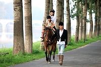 Family riding horse