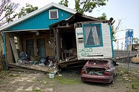 A home sits atop a car 9 months after Hurricane Katrina, in the Lower Ninth Ward, New Orleans