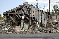 A destroyed home with a chair in front  9 months after Hurricane Katrina, Lower Ninth Ward, New Orleans