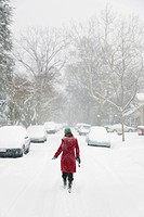 Caucasian woman walking in snow storm