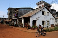 Street Scene with boy riding bicycle, Savannakhet, Laos, Southeast Asia
