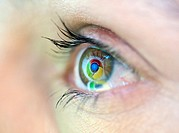 Logo of Google Chrome internet browser reflected in woman`s eye