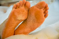 A pair of feet with bath foam