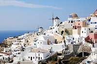 Greece, Cyclades, Santorini  Village of Oia with its white houses and windmills