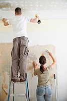 Young couple redecorating