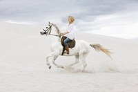 White horse with blond girl_rider, beach