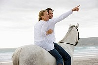 White horse, couple, sea, sand, beach