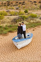 Business_couple lost in desert