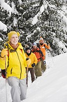 Italy, South Tyrol, Young people snowshoeing