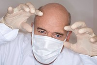 Germany, Bavaria, Landsberg, Dentist wearing mask, portrait