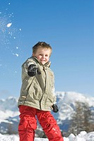 Italy, South Tyrol, Seiseralm, Boy 3_4 throwing snow in the air, portrait