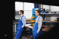Germany, Neukirch, Young woman and foreman at workstation, having a break