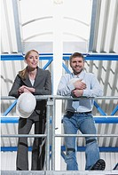 Germany, Neukirch, Man and female architect standing in industrial hall
