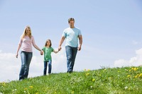 Germany, Bavaria, Munich, Family taking a walk, holding hands