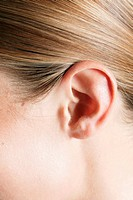 Woman's ear, full frame, close_up