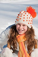 Austria, Salzburger Land, Altenmarkt, Girl 10_11 on sled, smiling, portrait