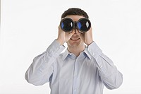 Businessman using binoculars, portrait (thumbnail)