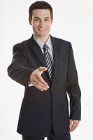 Businessman putting forth his hand, smiling, portrait