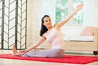 Woman doing yoga exercise, portrait