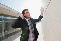 Spain, Mallorca, Businessman using mobile phone, gesturing